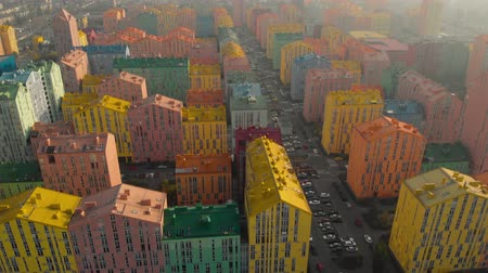 Aerial view of the colorful buildings in european city at sunset. Cityscape with multicolored houses, cars on the street in Kiev, Ukraine. Top view. Urban landscape. Aerial video of architecture. Stock Footage