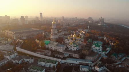 Aerial view at sunrise of the Kiev-Pechersk Lavra - one of the main symbol of Kiev, Ukraine. Drone view of Pechersk Lavra in Kiev. A UNESCO world heritage site in Ukraine. Camera moves forward.