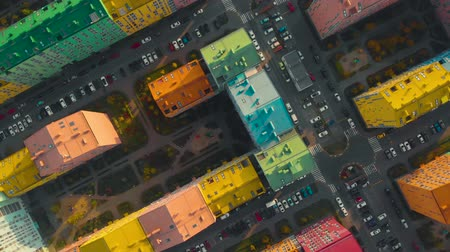 flat head : Fall down over residential colored houses. Free fall effect with rotation. Air crash over residential areas in the city. Air crash concept. Fall down at high speed. POV. Top down view, video footage.