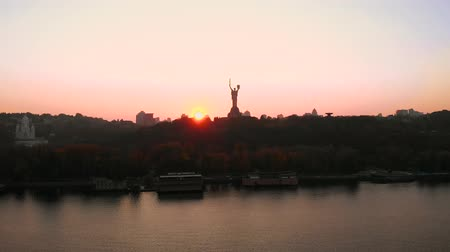 미드 타운 : Kiev city - Capital of Ukraine. The famous Motherland Monument statue also known as Rodina Mat under dramatic sunset sky in autumn. Aerial view, video footage.