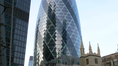 foster : Ð¡lose-up view of The Gherkin (30 St Mary Axe), one of the most famous landmarks of London, UK. Gherkin Office Building In The City Of London. Panorama from bottom to top. Stock Footage