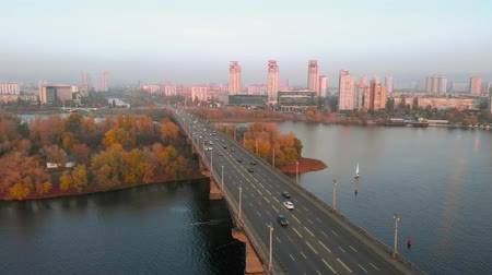 мостовая : Road bridge against the backdrop of a big city in the sunset light, aerial view.