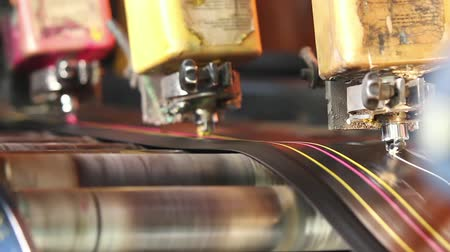 reciclado : Machine for marking rubber bands with colored paints cutting into pieces for the further production of automobile tires. Rubber tape on a rolling machine. Rubber band before molding at a tire factory.