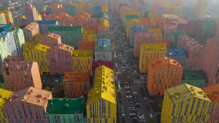 townhouse : Drone flight over colorful houses residential district at sunset, Comfort Town, Kiev, Ukraine. Panoramic aerial view of multicolored buildings on city street. Horizontal panorama. Aerial view.