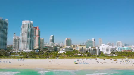 vacant : Aerial drone view flight over Miami City. South Beach sand and ocean from above at sunny day. Beach chairs and umbrellas on the coastline. Aerial view shot of South Beach. Miami Beach. Florida. USA.