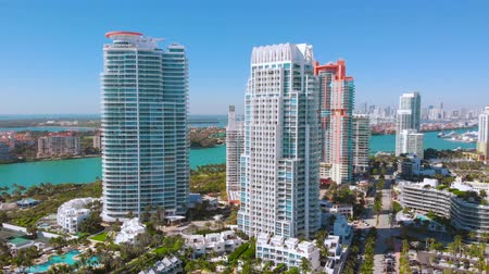 magasság : Aerial view of skyscrapers in Miami Beach. Close up drone view Of Miami Beach, hotels and skyscrapers near South Pointe Beach and coastline, Florida Beaches, resort cities, city lndscape in Miami City