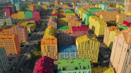 maison de ville : Multicolor houses in the city. Aerial view of the colorful buildings in european city at sunset. Colored residential buildings. Infrastructure of a modern residential area with colorful houses. Aerial Vidéos Libres De Droits
