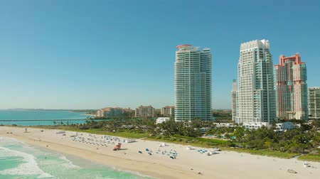 urban birds : Aerial drone view flight over Miami beach. South Beach sand and sea, ocean from above at sunny day. Drone flies forward near South Beach, Miami, Florida. Aerial view of skyscrapers in Miami Beach, 4k.