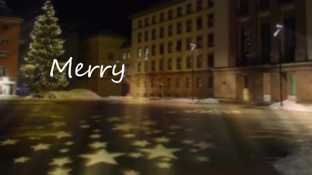 Merry Christmas greetings in the background at famous square in Innsbruck. Stok Video