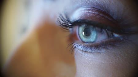 bulva oční : Macro view of a discreet woman with bright makeup, slidecam