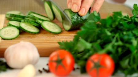 prepare food : Female hands chopping cucumber Stock Footage
