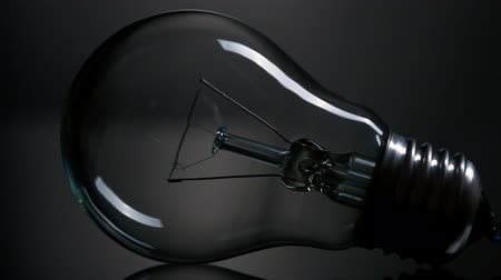 light : Light bulb over black background