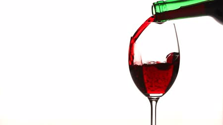 vinho : Pouring red wine into a glass on white background