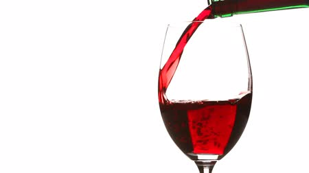 beyaz şarap : Pouring red wine into a glass on white background