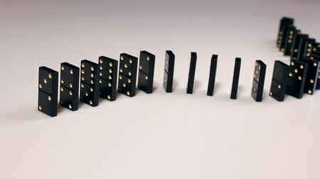 block chain : Finger pushing dominoes in a row causing a chain reaction
