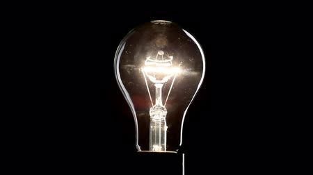bulbo : Light bulb over black background