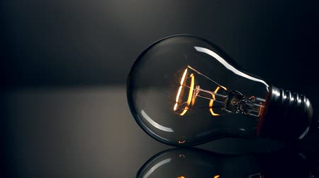 electric : Light bulb on black background Stock Footage