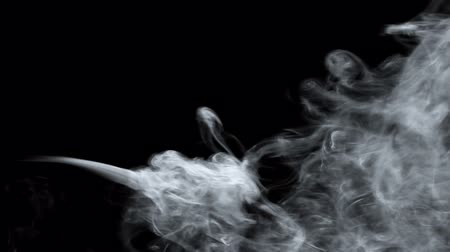 sobre o branco : Smoke over black background Stock Footage