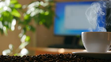 sabah : Cup of coffee in office. 4K Stok Video