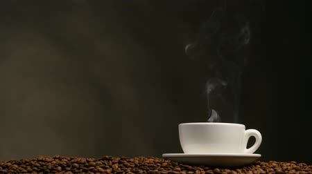 kahve molası : Cup of coffee on dark background. UHD, 4K