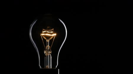 Light bulb over dark background. UHD, 4K Стоковые видеозаписи