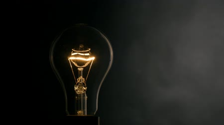 bulbo : Light bulb over black background.