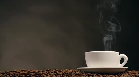 kahve molası : Cup of coffee on dark background. Slow motion