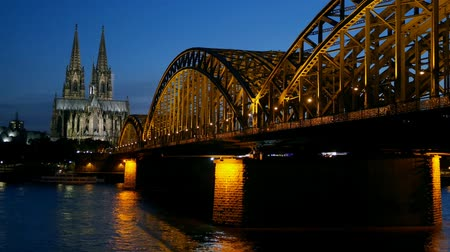 kolínská voda : Gothic Cathedral and iron bridge across Rhine river after sunset. Cologne, Germany