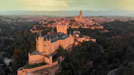 segovia : Aerial view of Alcazar of Segovia, a medieval fortress in the central part of Spain. After sunset view. 4K, UHD