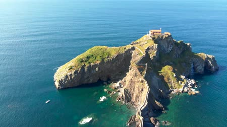 basque : Aerial view of Gaztelugatxe - an islet in Basque Country, Spain, during a bright sunny day. 4K, UHD
