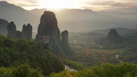 kalambaka : Meteora Monastery, Greece at sunset lights. Panning shot