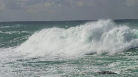 storming : Slow motion shot of large ocean waves coming towards the coast Stock Footage