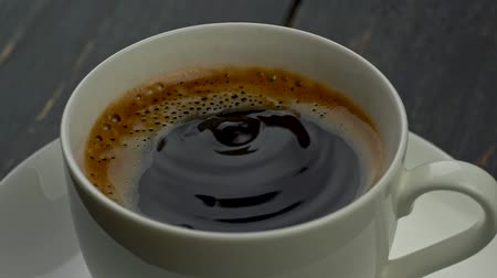 wavelets : Coffee drops falling into a coffee cup, covered with appetizing foam. Slow motion