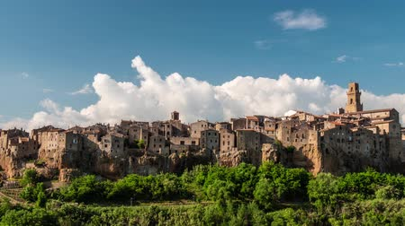 protrude : Pitigliano, Italy. Old houses that protrude from a large outcrop of tuff. Time lapse, 4K