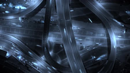 Highway interchange with traffic. Aerial shot. UHD, 4K