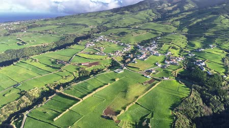 furnas : Sao Miguel Island, Azores, Portugal. Villages and green fields during a bright sunny day. Aerial shot, UHD Stock Footage