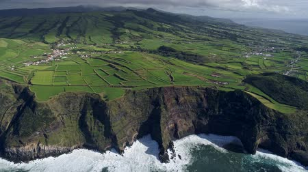 faca : Flying over a coast of Sao Miguel Island in the Azores, Portugal. The island is volcanic and is located in Atlantic ocean. Oftentimes it is called The Green Island. Aerial shot, UHD