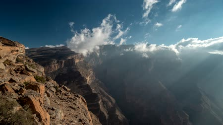 Landscape of Oman mountains, Arabian Peninsula. Time lapse of Jebel Shams mountains (Mountain of Sun) and gorge in Oman at sunrise Stock mozgókép