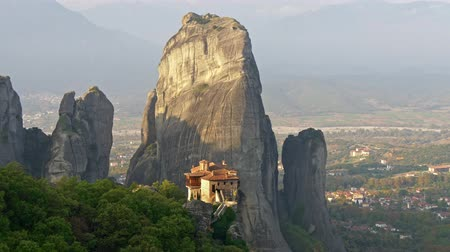 Scenic view of vertical rocks and monasteries in Meteora, Greece. Meteora is the second most important place of Eastern Orthodox Christianity. Panning shot, UHD