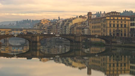 Panning shot of Florence (Firenze) bridges and old houses, Italy Stock mozgókép