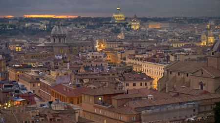 Rome, Italy. Panning shot of Rome old city center after sunset. Illuminated houses and St Peters Cathedral In Vatican, Rome. 4K, UHD Стоковые видеозаписи