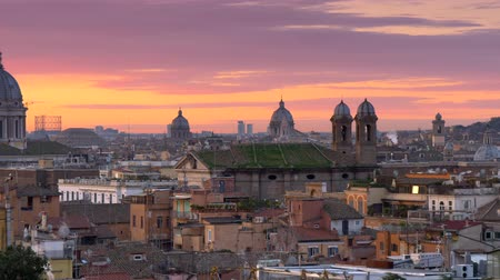 Sunrise in winter Rome, Italy. Panoramic shot of beautiful Rome from Terrazza del Pincio with red and vanila morning sky background.