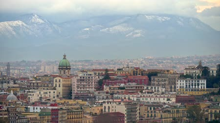 Panoramic view of winter Naples with snowy mountains background. 4K, UHD