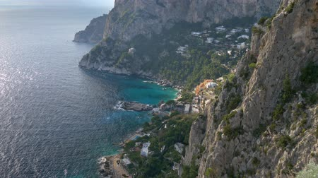 Mountains and the sea landscape of the Capri island, Italy. Located in the Tyrrhenian Sea, Capri has been a place of resort for several thousand years. Tilt shot, UHD