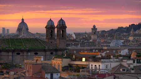 Rome, Italy. Scenic panorama of the city during sunrise. Pink and golden sky. UHD Стоковые видеозаписи