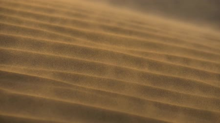 slomo : Sand waving in the wind in dunes in desert. Slow motion shot