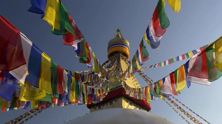 prayer flag : Colorful flags with Buddhist scriptures on a stupa in Nepal. UHD 4K