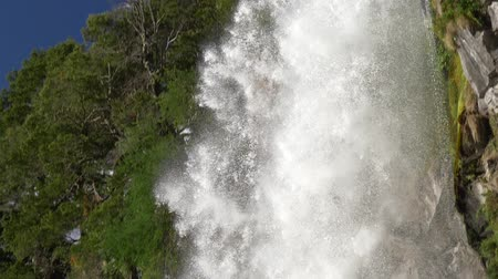 andy : Slow motion shot of water masses slowly falling from a rock of a waterfall in Andes mountains in Patagonia, Argentina. Los Lagos Department