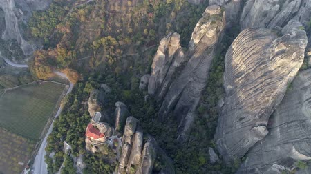 meteora : Flying over Meteora, Greece. Meteora is a rock formation, where major monastery system of Eastern Orthodox Christianity (second only to Mount Athos) is located. Aerial top down shot, 4K Stock Footage