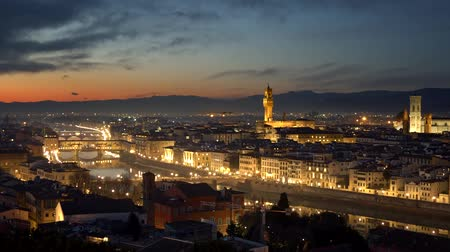 vecchio : Florence, Italy. Panorama of the evening city after sunset. The Florence Cathedral, the Torre di Arnolfo tower, the Ponte Vecchio bridge across Arno is seen in this panorama. 4K Stock Footage